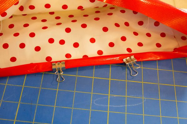 Oilcloth Garden Tote Tutorial - Use binder clips to hold the binding in place