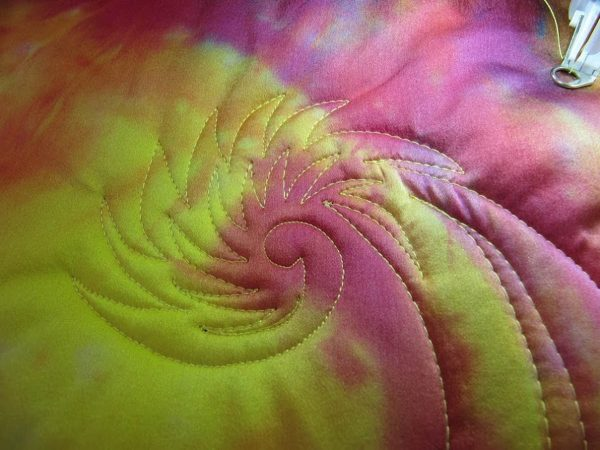 Wholecloth Artquilt Series Part II - quilting in a spiral echo pattern