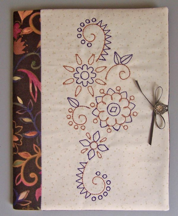 Embroidered Journal Cover-tie the ribbon around the button to hold the journal closed
