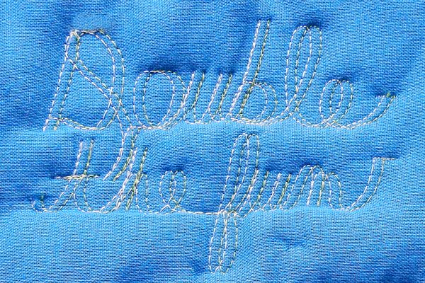 Double Needle Free Motion Quilting Cursive Wording