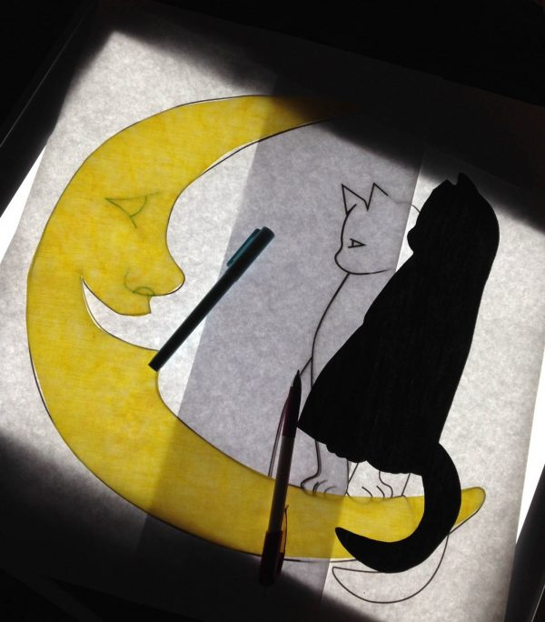 Moon Wall Hanging-Trace the features using a chalk pencil on the black fabric and blue water-soluble pen on the yellow moon
