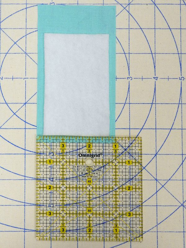 ironing on batting 1200 x 1600 BERNINA WeAllSew Blog fabric gift tag