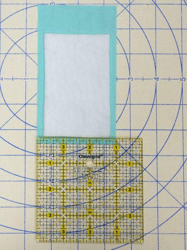 ironing on batting 1200 x 1600 BERNINA WeAllSew Blog fabric gift tag