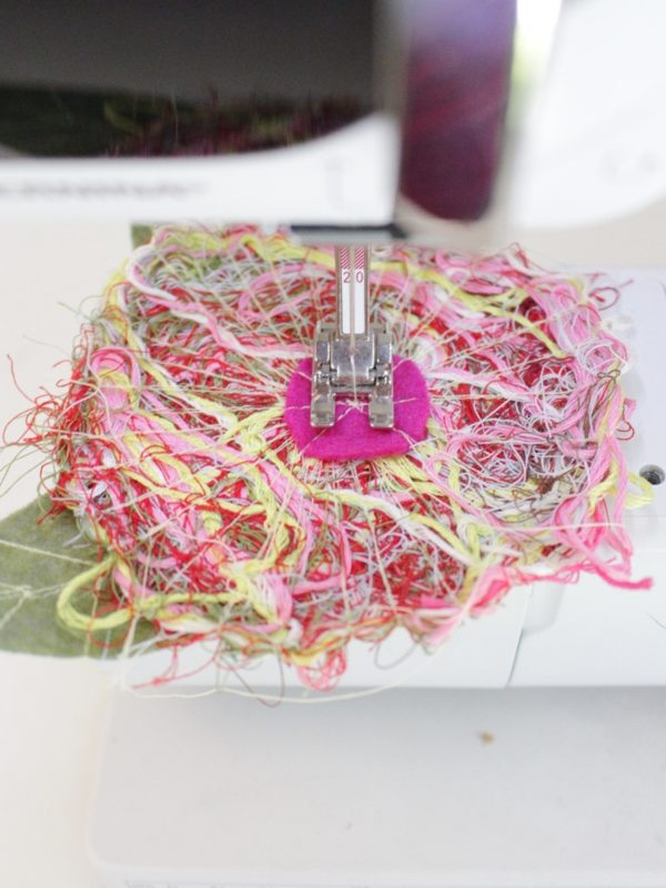 Recycled thread flower pin Step Nine: sew the center of the flower