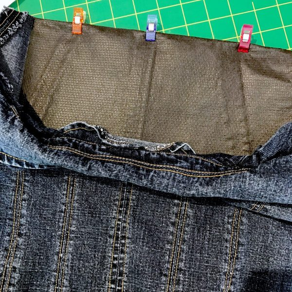 Fold the jacket, right sides together, on the horizontal marked line, clipping in place to hold. Set aside while we prepare the stabilizer.