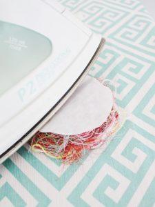 Recycled thread flower pin Step Three: Iron interfacing