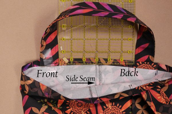 Easy Convertible Totebag/Backpack Tutorial Step 15: Sew the ends of the straps to the top inside edge of the opposite side of the tote.