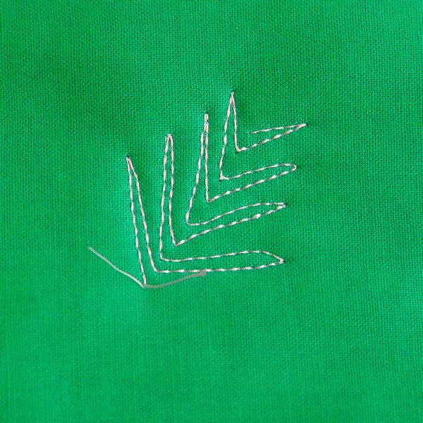 Free-motion Quilting Pine Boughs and Holly- stitch shorter lines so the bough tapers at the tip