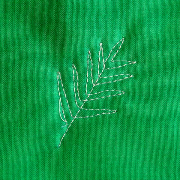 Free-motion Quilting Pine Boughs and Holly-stitching the top