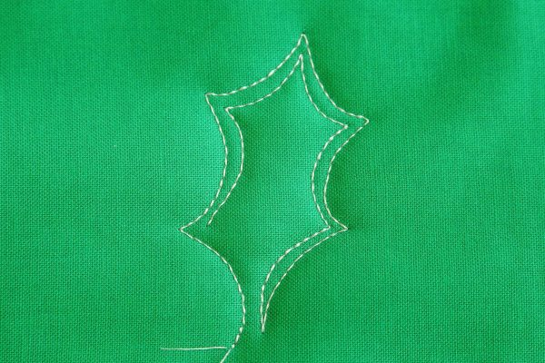 Free-motion Quilting Pine Boughs and Holly-Echo Stitching on the inside of the leaf