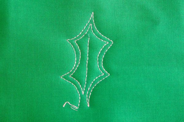 Free-motion Quilting Pine Boughs and Holly-stitch into the center to create a vein