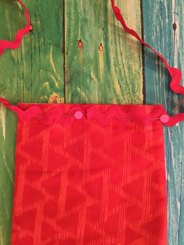 Jingle Bell Door Banner - Pinning ric rac yarn