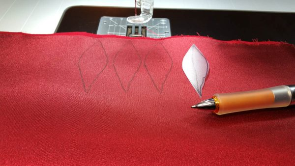 Poinsettia Pin-Trace the larger petal shape onto the fused satin and felt