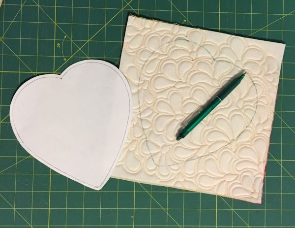 Chocolate Box Cover and Mug Rug-trace the heart pattern on the wrong side of the quilted square