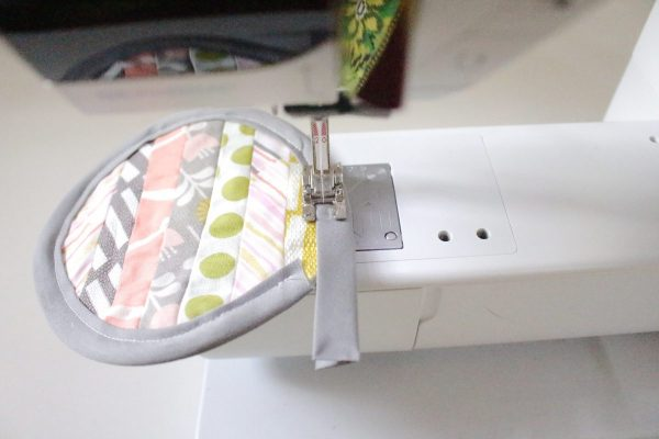Modern Patchwork Coasters Tutorial Step Eleven: sew bias tape on edge