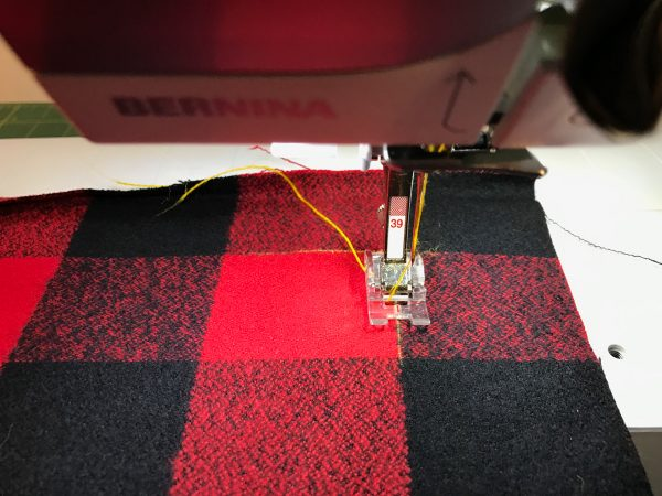 DIY Blanket Scarf-Start sewing aligning the center mark of the presser foot along a line in the plaid