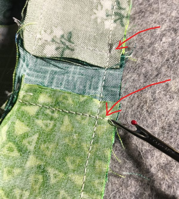 Shamrock Table Runner-With a seam ripper, remove the two or three stitches between the seam