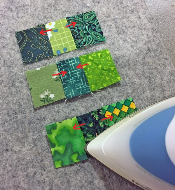 Shamrock Table Runner-Sew the scraps into three rows, then press the seams alternately