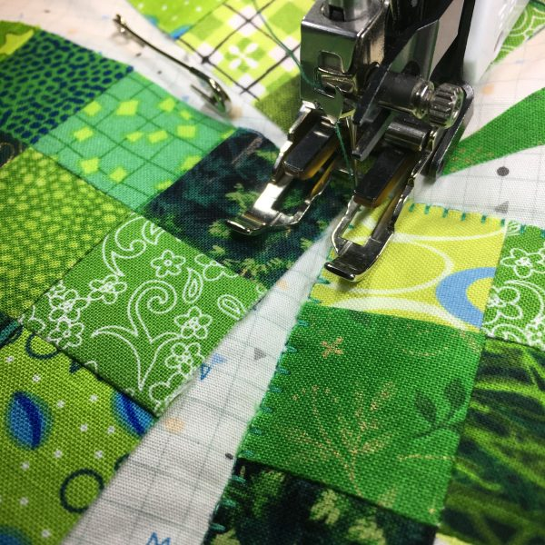 Shamrock Table Runner-blanket stitch around the appliqué shapes through all layers