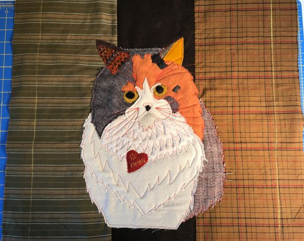 Pet Applique Pillow-trim the fabric pieces with the cat