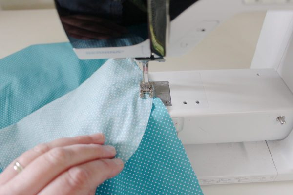 step five: sew the bottom fabric to the sides