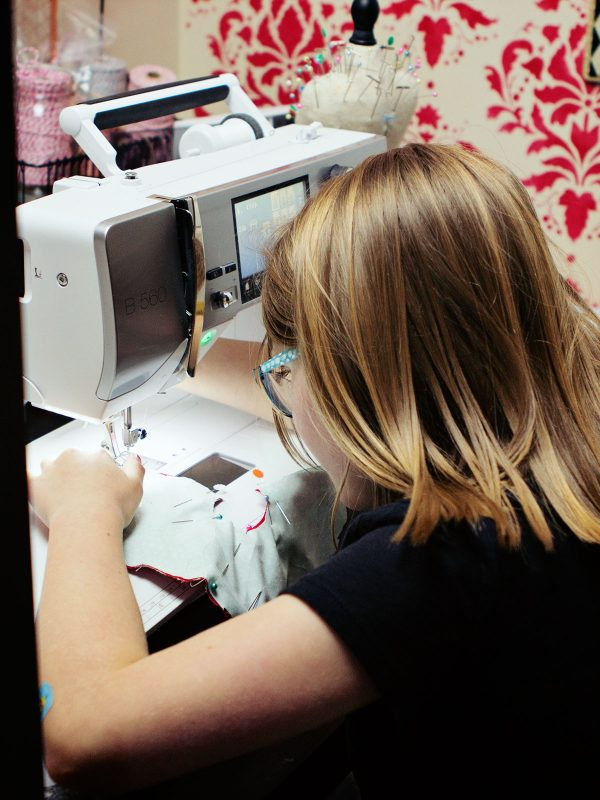 little girl at BERNINA 560 machine