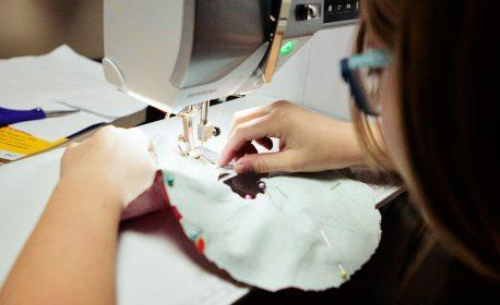 kid sewing on a BERNINA 560