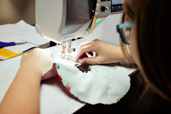 kid sewing on a BERNINA 560