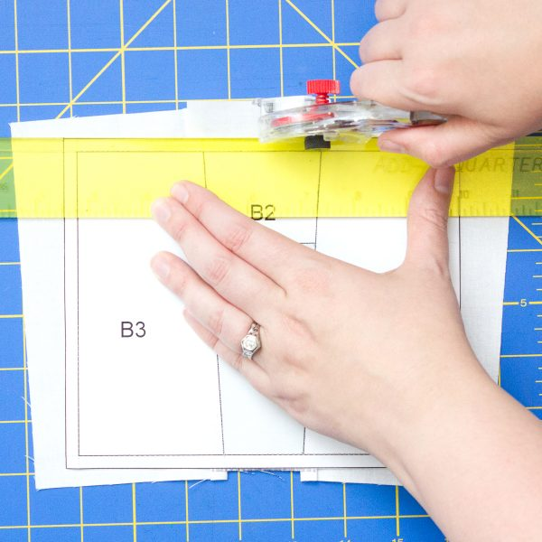 Get Happy Quilt Step Fifteen: Trim along outer border