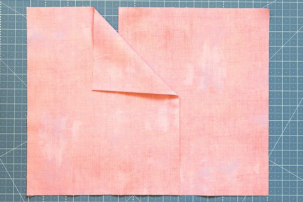 fold the pillow backing rectangles in half and overlap
