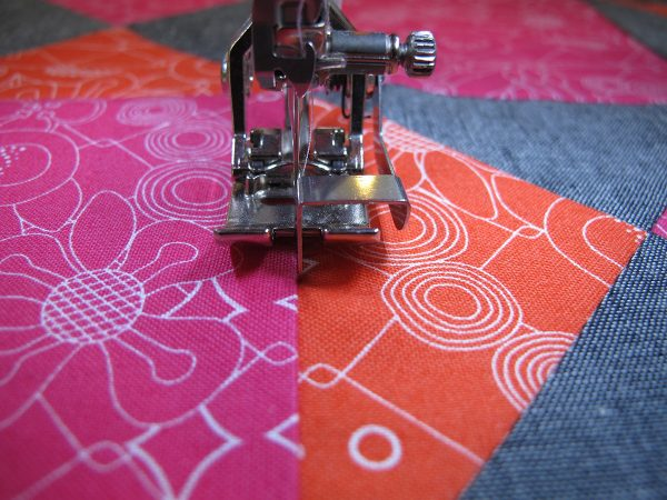 Let the guide on the sole ride in the seam and stitch