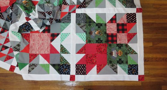 https://weallsew.com/wp-content/uploads/sites/4/2017/12/Quick-Christmas-Quilt-1200-x-800-Feature-555x300.jpg