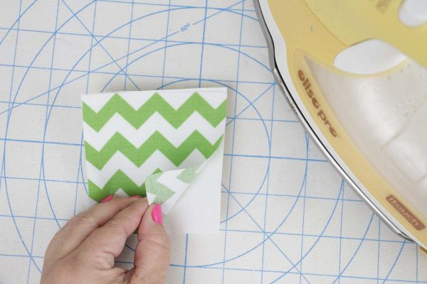 Shamrock Door Hanger In the Hoop step two: press applique to fusible web