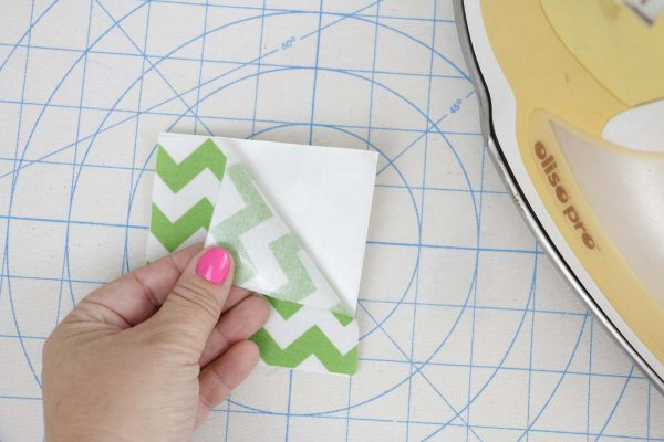 Shamrock Door Hanger In the Hoop step two: remove fusible web paper