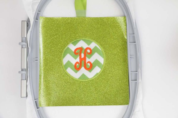 shamrock door hanger in the hoop Step 6, Sew Monogram, sew letter monogram