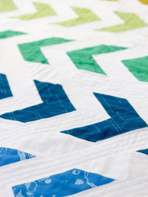 Arrow Baby Quilt with Half-Square Triangles by Lee Heinrich