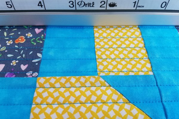 Straight Line Quilting with Q-matic, check quilting