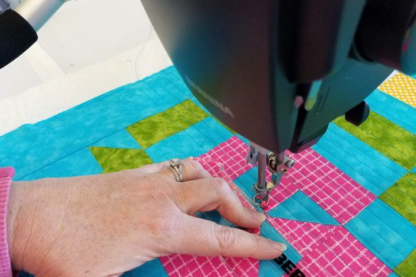 Straight Line Quilting with Q-matic, ruler closeup
