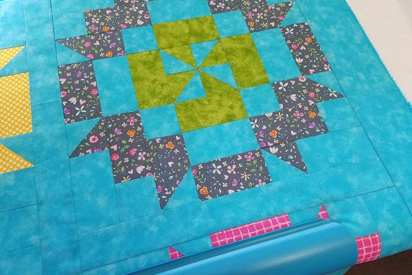 Straight Line Quilting with Q-matic, load quilt