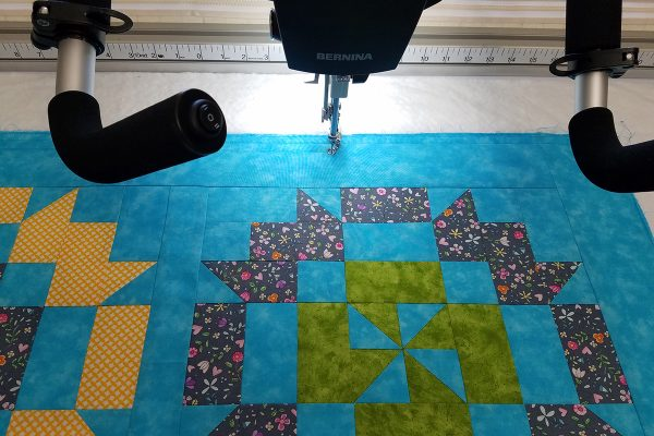 Straight Line Quilting with Q-matic, begin stitching