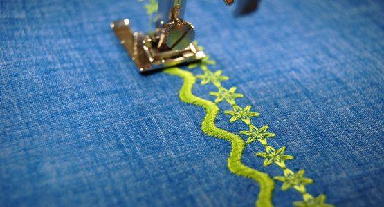 https://weallsew.com/wp-content/uploads/sites/4/2018/05/Decorative-stitch-tips-1200-x-800-satin-and-open-555x300.jpg