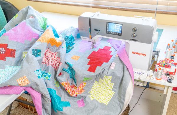 Scrunching the quilt under the machine