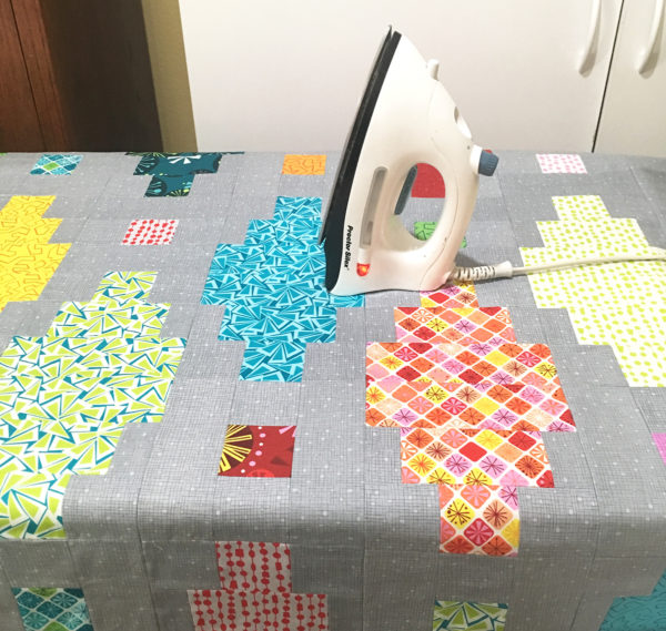 Press the quilt to set the glue.