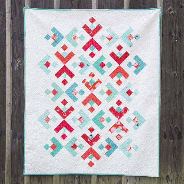 Winter holiday snowflake quilt at WeAllSew