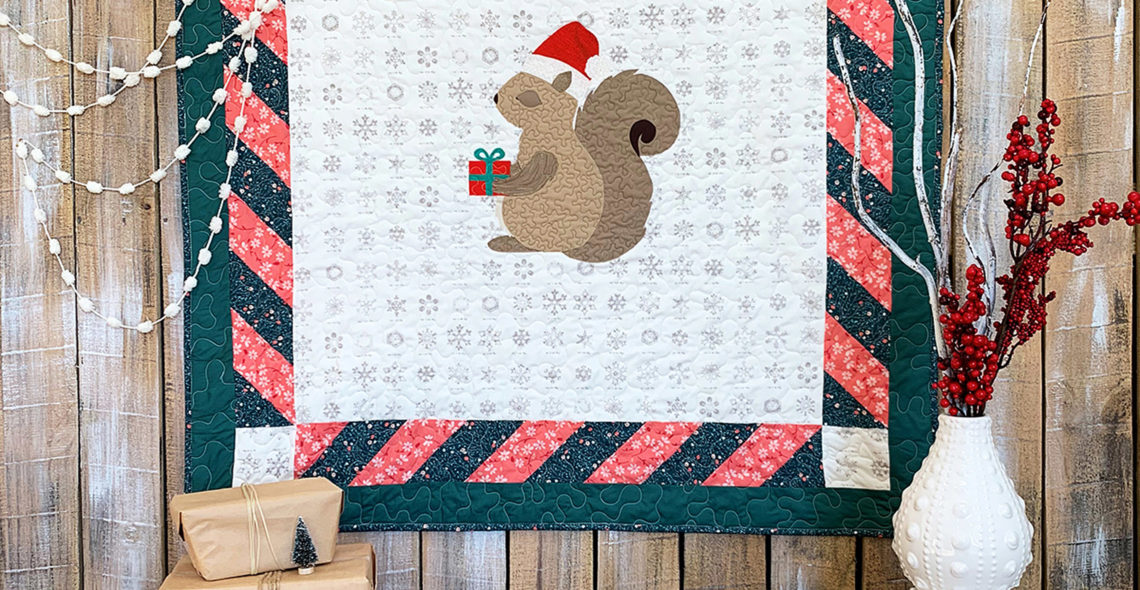 Coco the squirrel baby quilt at WeAllSew