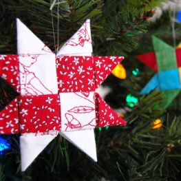 I've been playing with making folded Danish stars (sometimes called a German or Froebel star) from fabric to decorate for the holidays. While there's a few methods you can use to create these folded stars from fabrics, I found that using sewn strips reduced some of the bulk and creates nice, crisp corners. There's just one straight line seam in these stars, the rest is all folding!