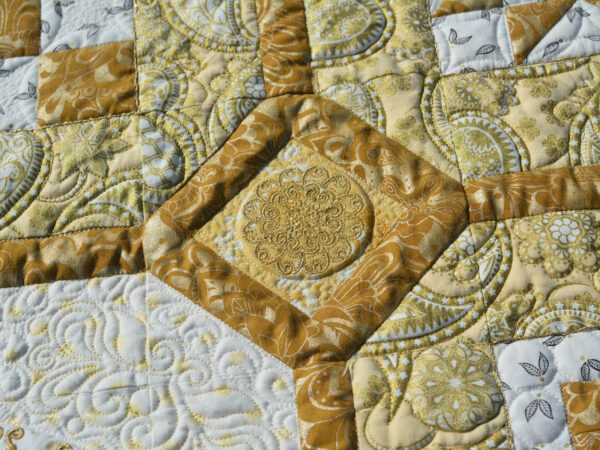 The cornerstone embroideries on the BERNINA 125th Anniversary Quil