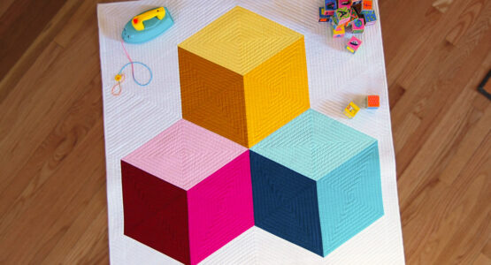 https://weallsew.com/wp-content/uploads/sites/4/2019/02/Colossal-blocks-quilt-1100-x-600-materials-feature-555x300.jpg