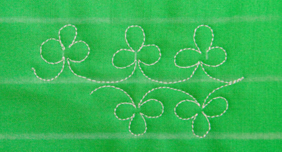 https://weallsew.com/wp-content/uploads/sites/4/2019/03/Free-motion-Stitching-Shamrocks-WeAllSew-Blog-1110x600-555x300.jpg