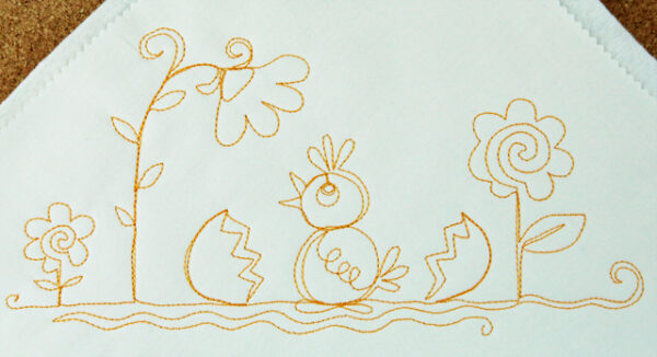 Free-motion stitched baby chicks motif